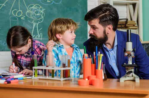 Teacher with his students in the science laboratory employing reality pedagogy.