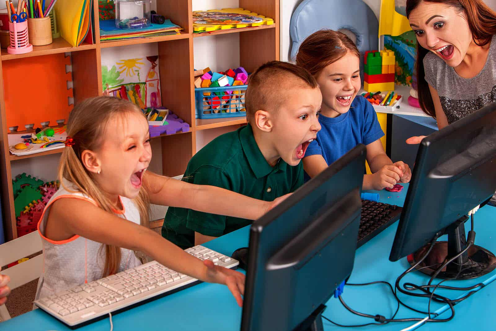 Elementary students excited to learn on computers.
