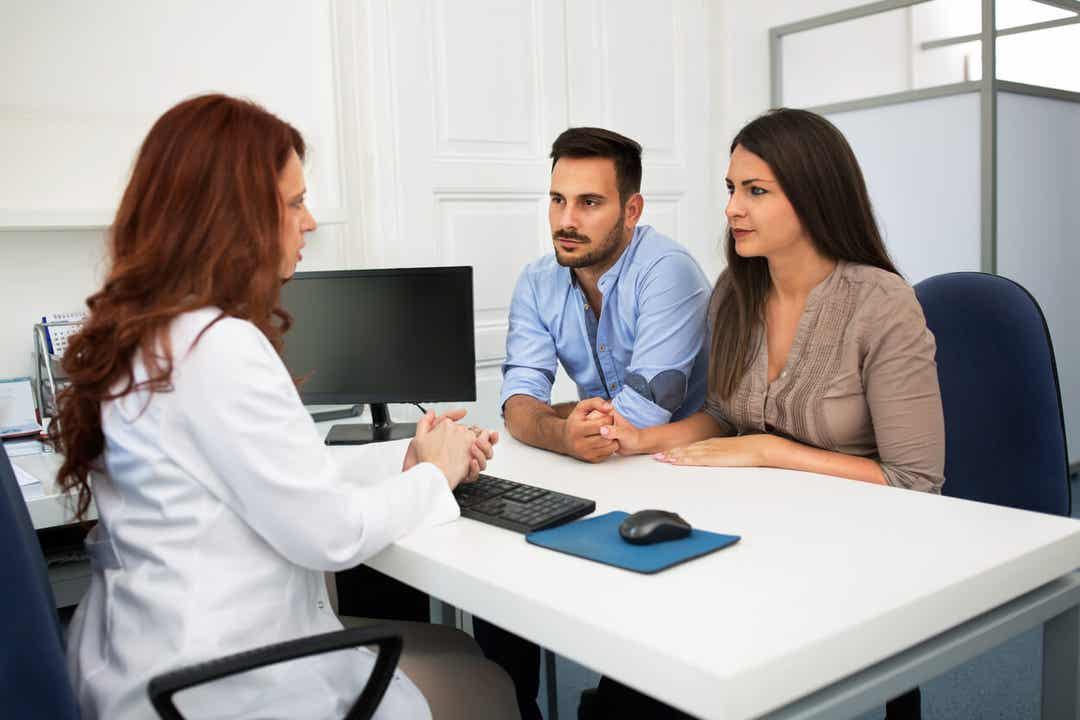 A couple talking with a fertility specialist.