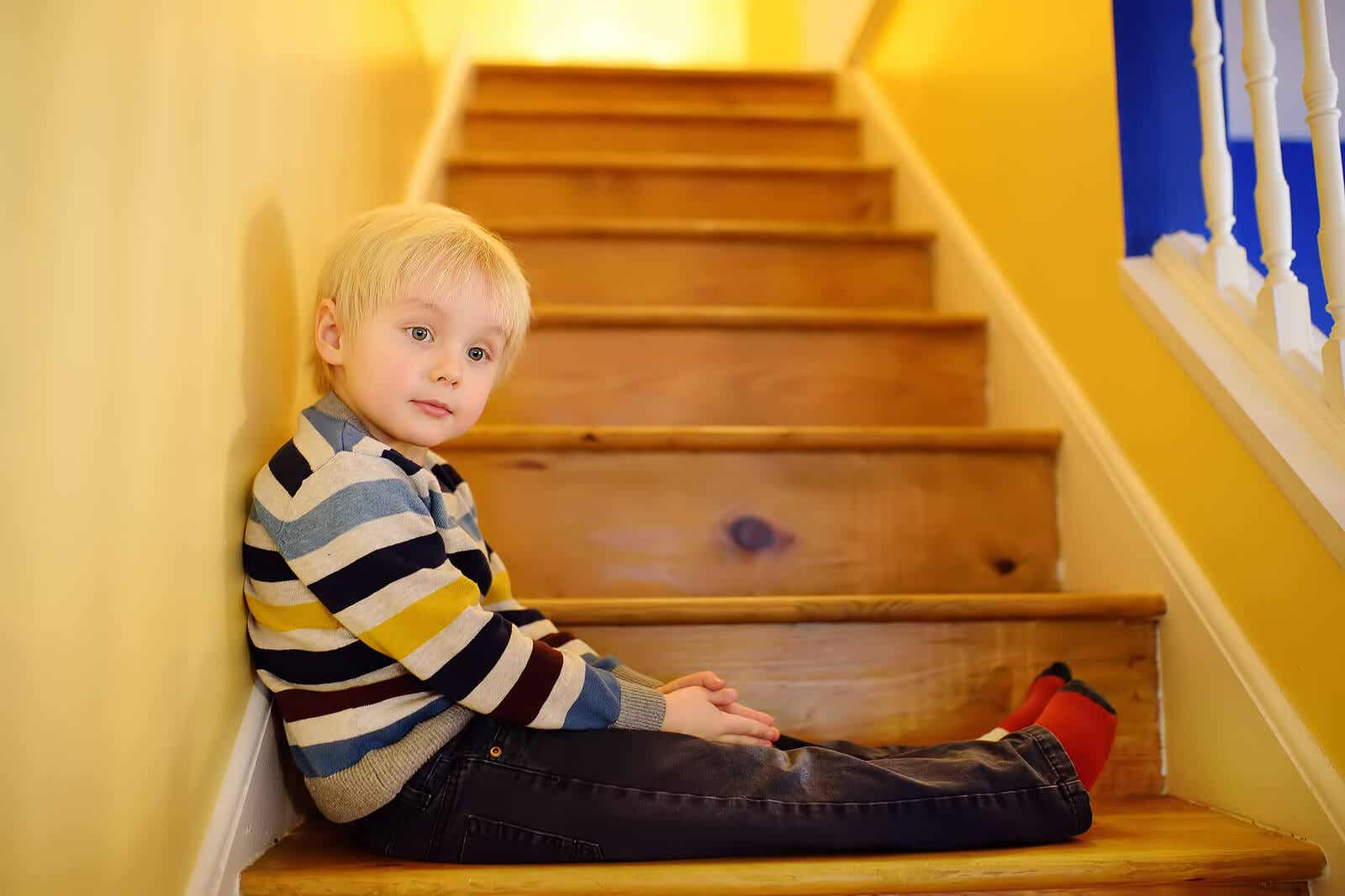 A child sitting on a staircase.