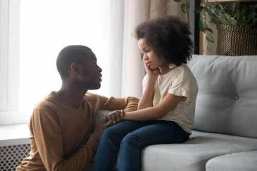 Father talking to his daughter about how to cope with the loss of a friend.