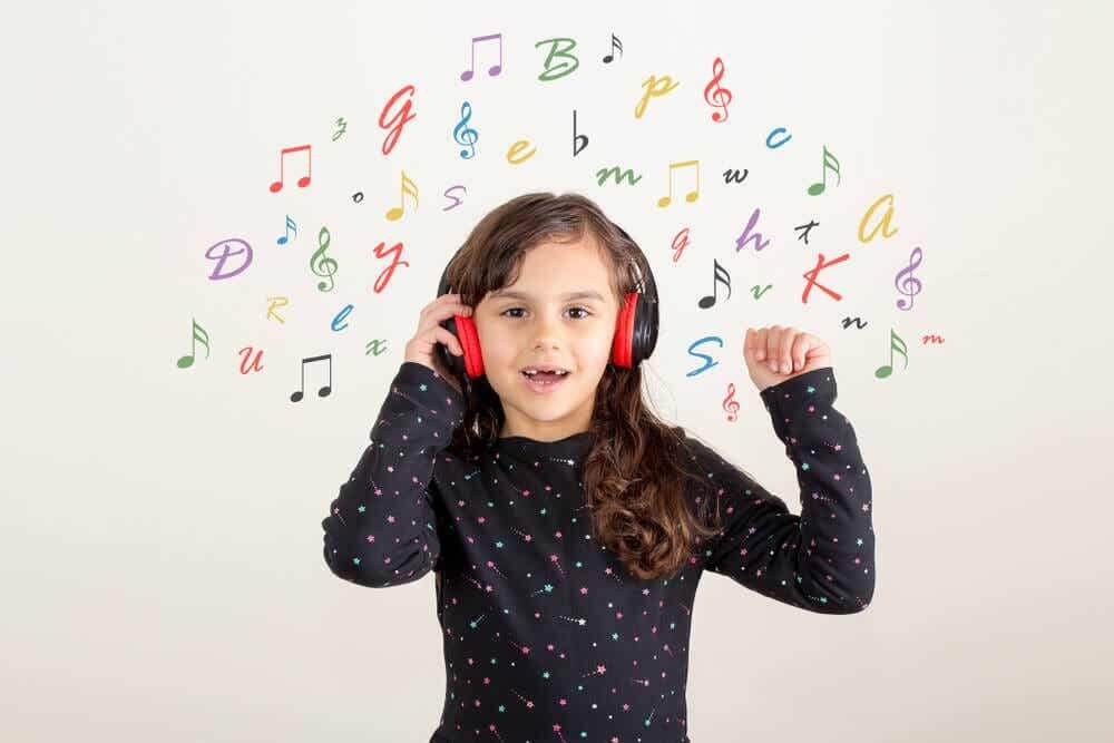 Girl listening to children's songs in English to learn the language.