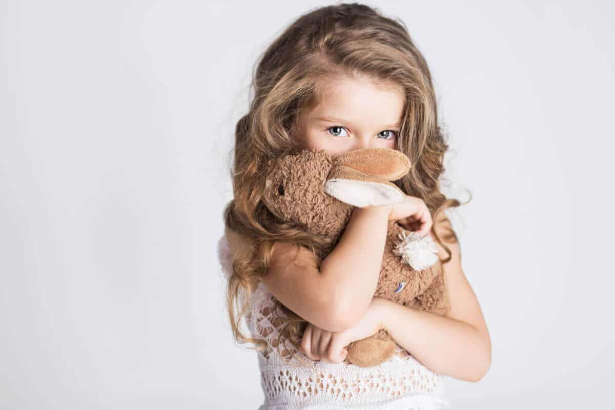 A girl with soft toy.