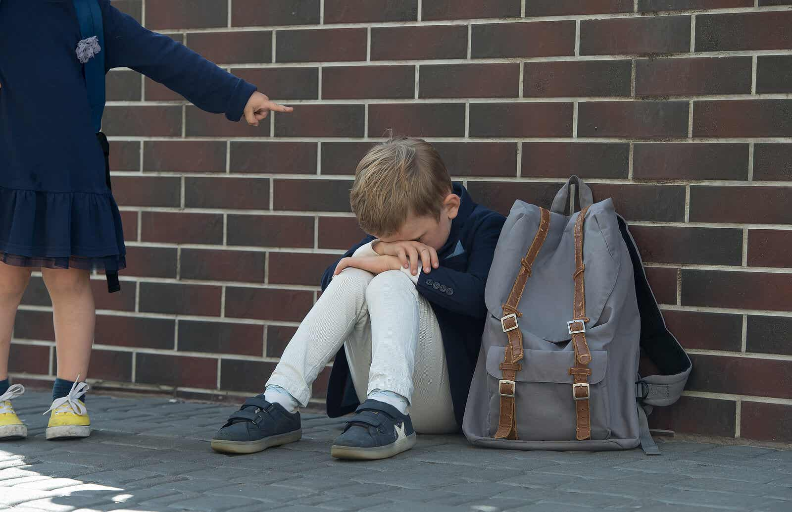 An elementary school boy suffering from bullying.