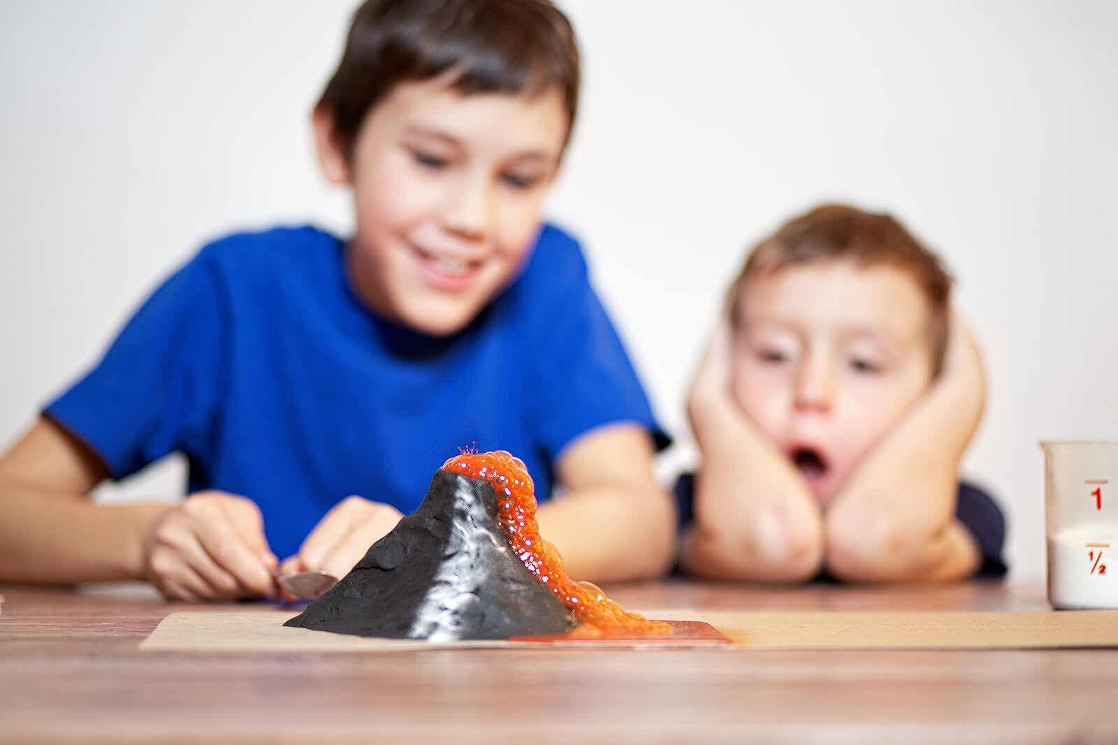 Children watching a homemade volcano erupt.