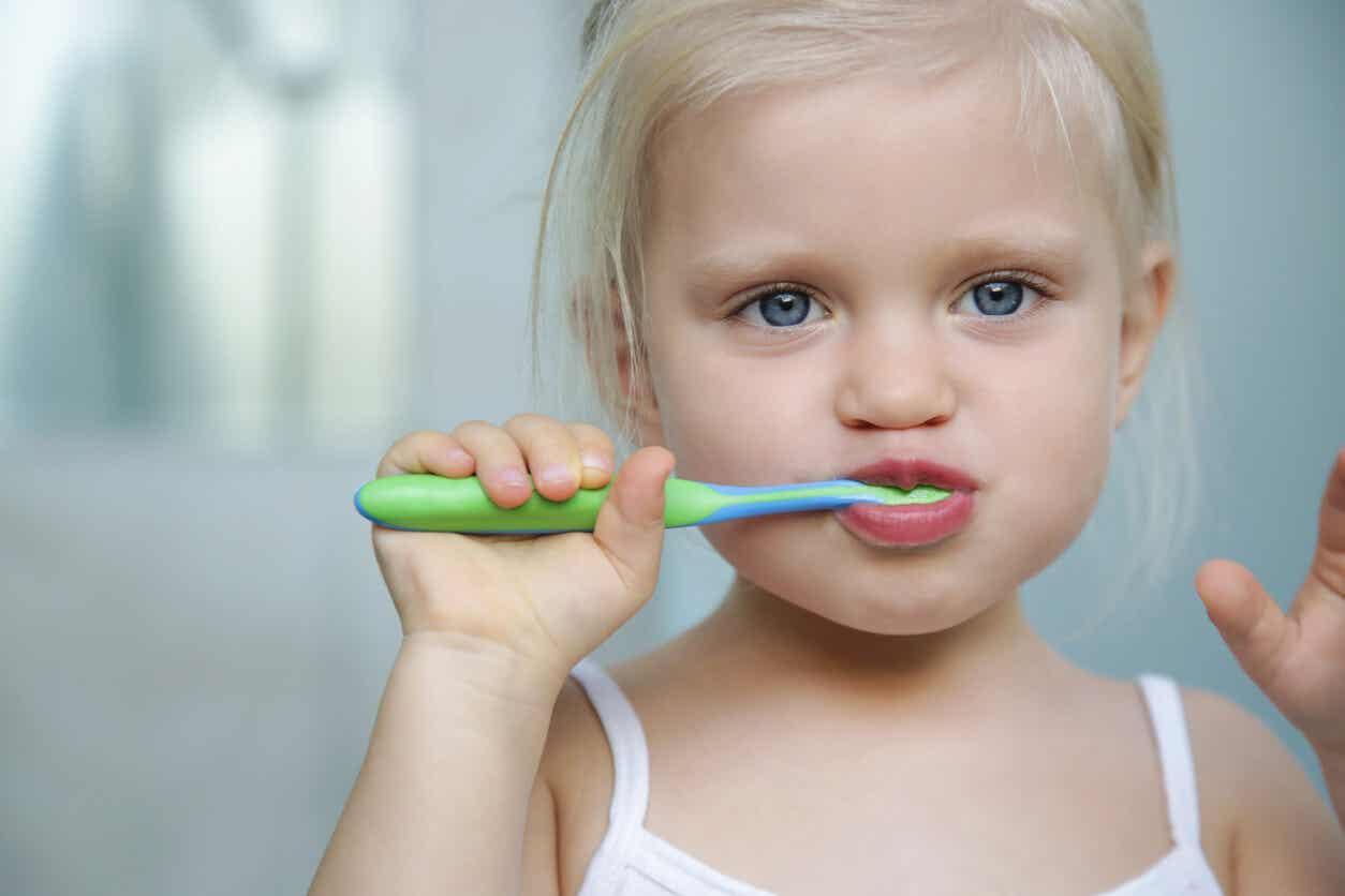 Girl brushing her teeth.