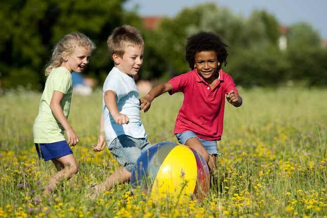 Kids playing outside in the summer.