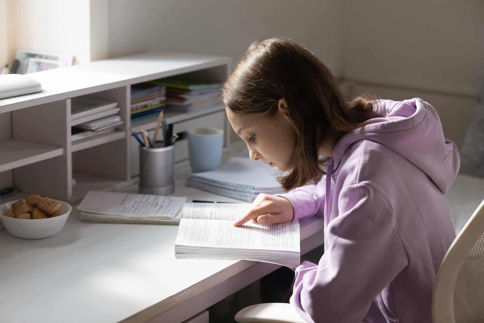 A preteen studying at her desk.