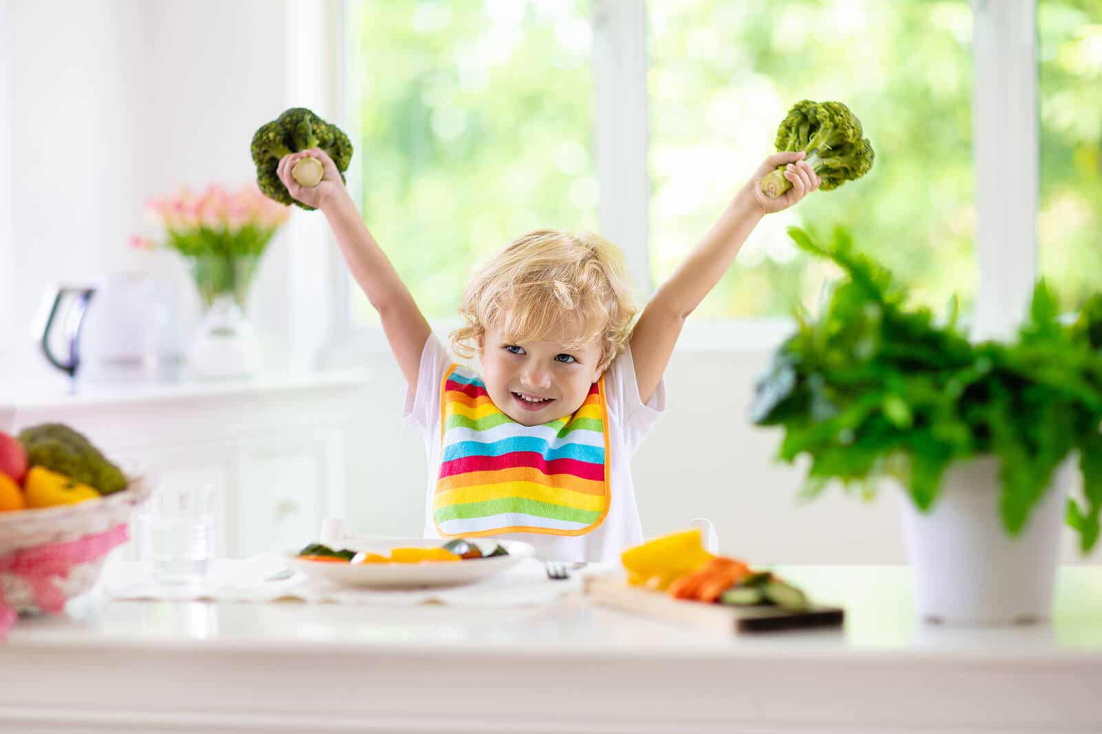 Happy child because he's going to eat fruits and vegetables.