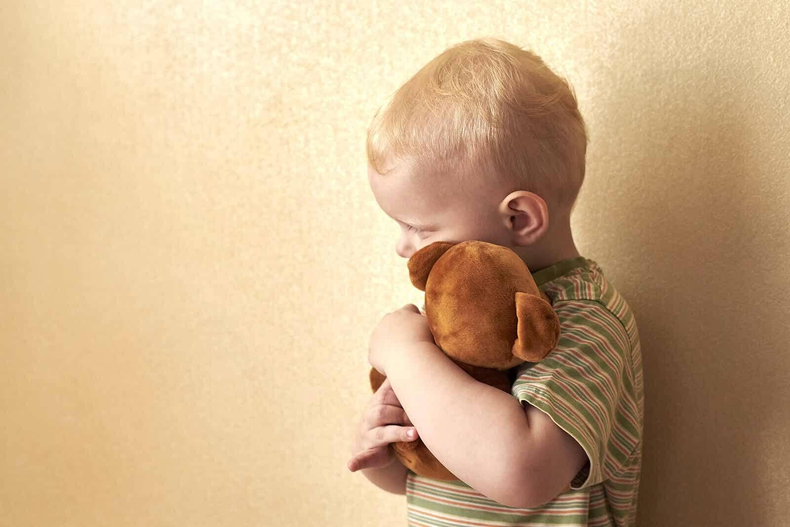 Child hugging a stuffed animal because he's afraid of death.