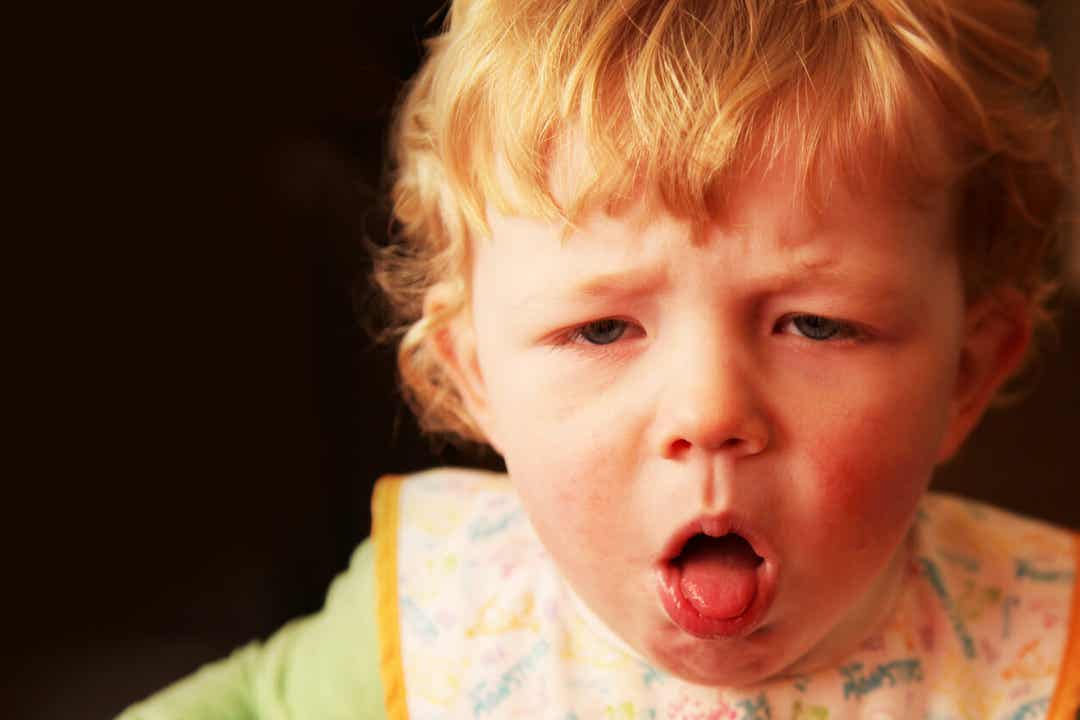 A baby coughing.