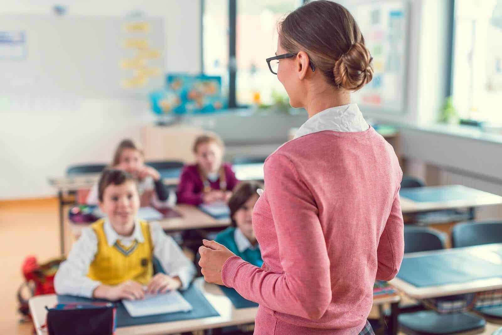 Teacher teaching her students.