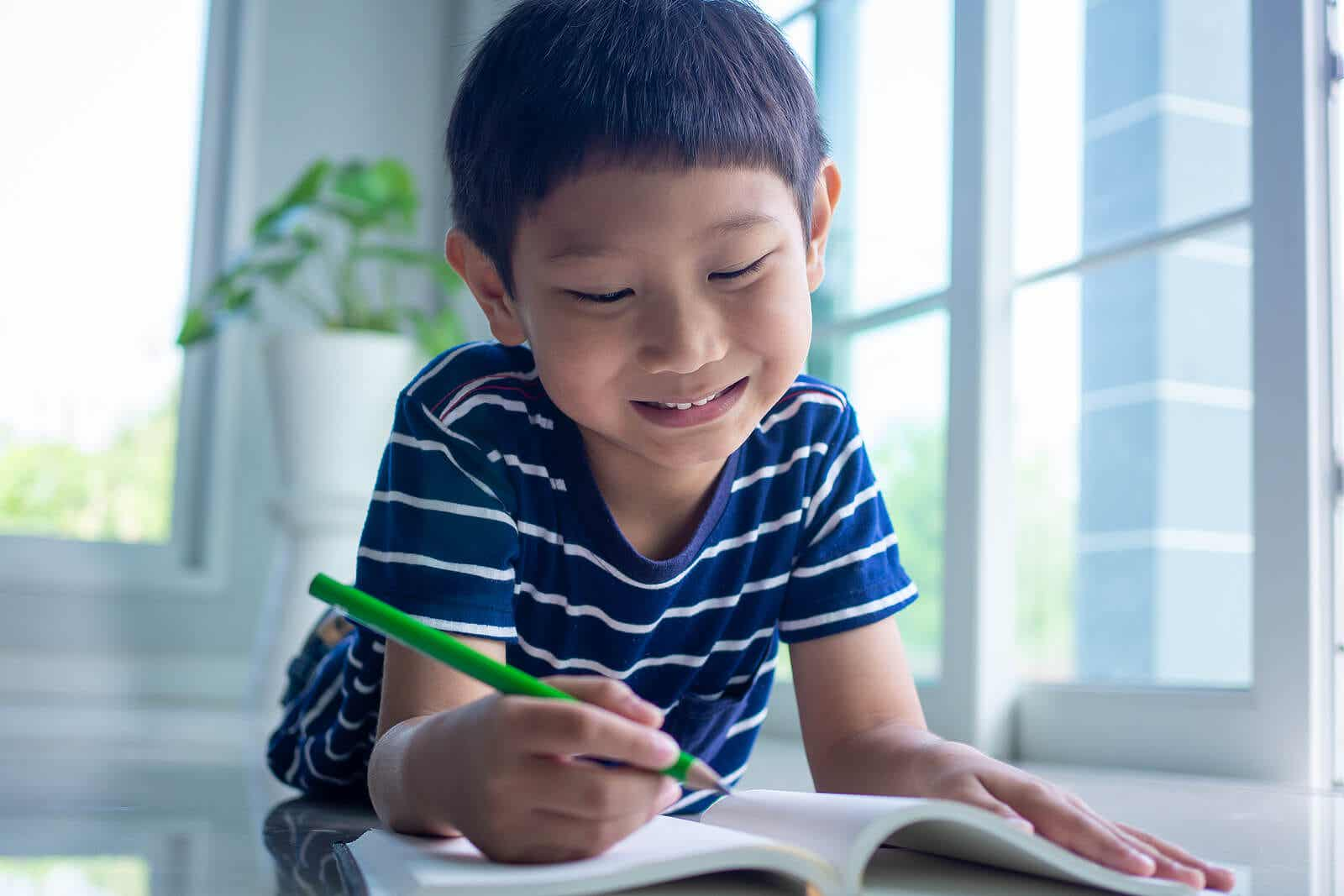 A child writing in a blank notebook.