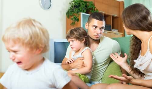 Parents arguing in front of their children because they're stressed.