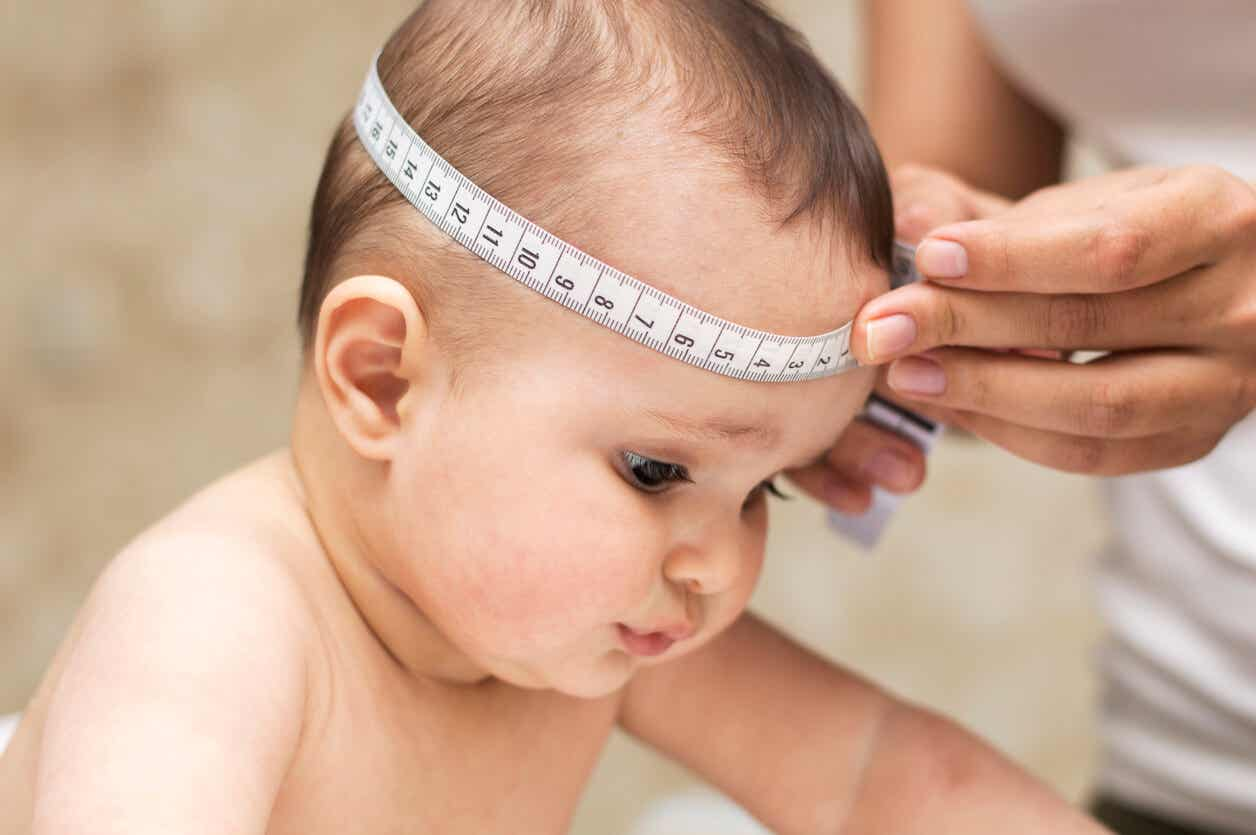 A doctor measuring a baby's head.