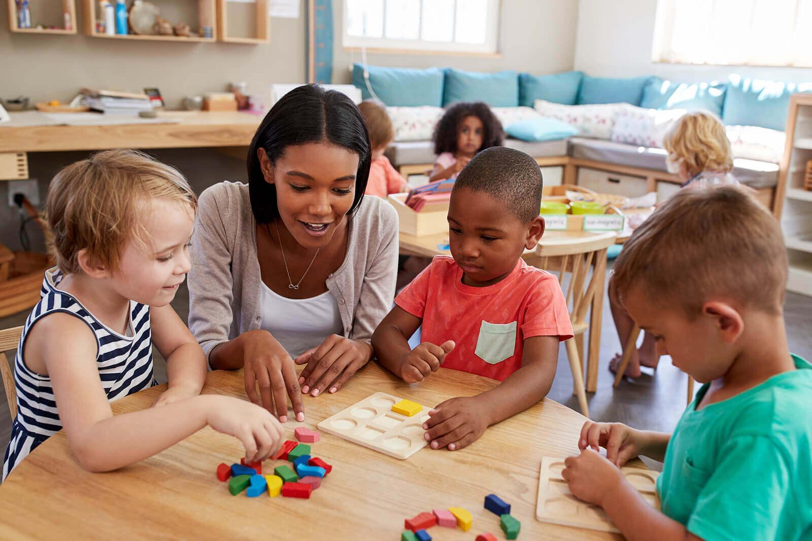 A teacher with preschool students.