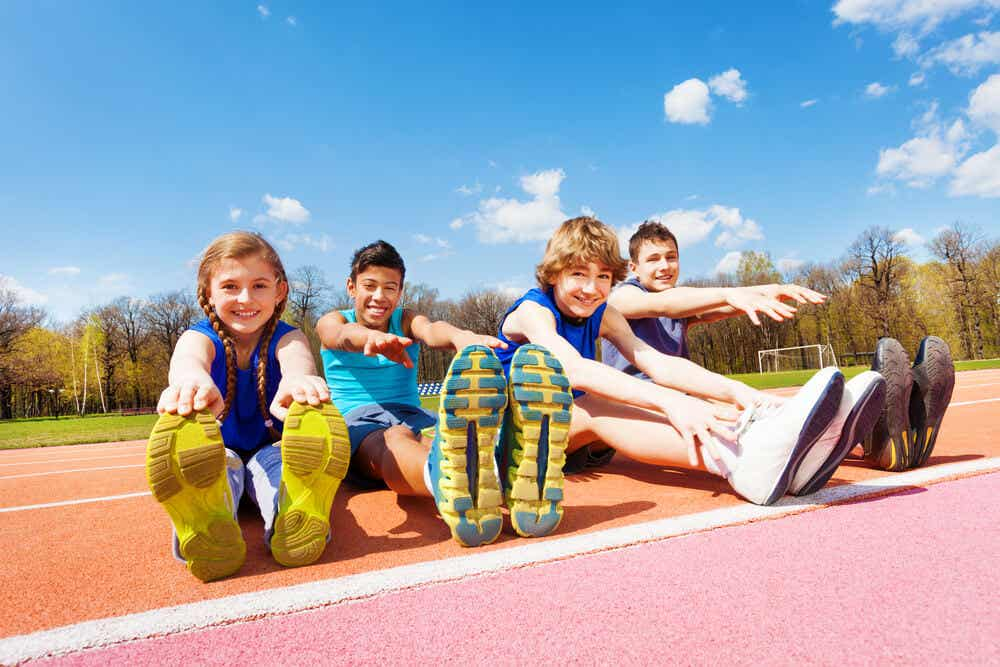 Children stretching on a track.