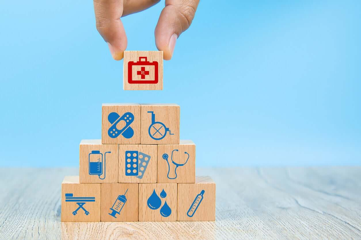 Building blocks with different health-related images on them.