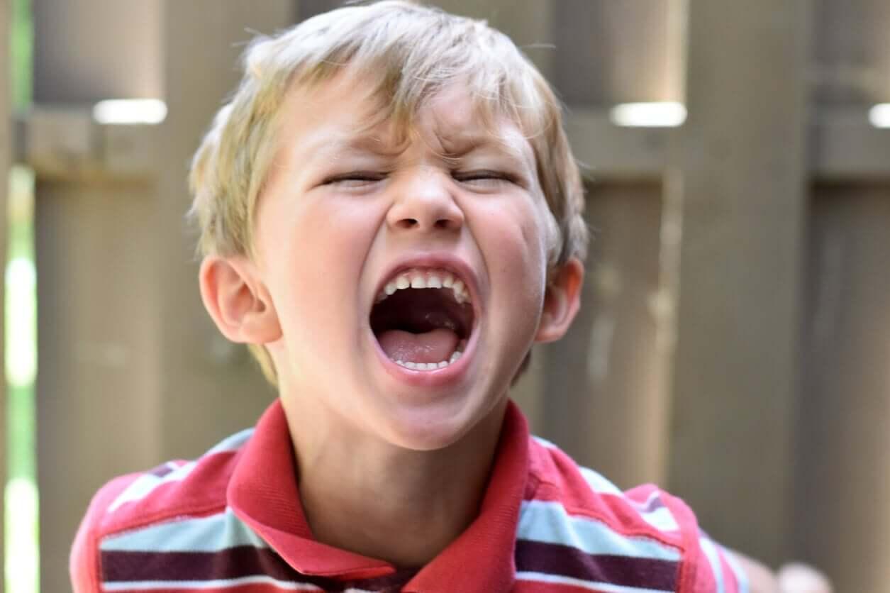 An angry boy screaming.