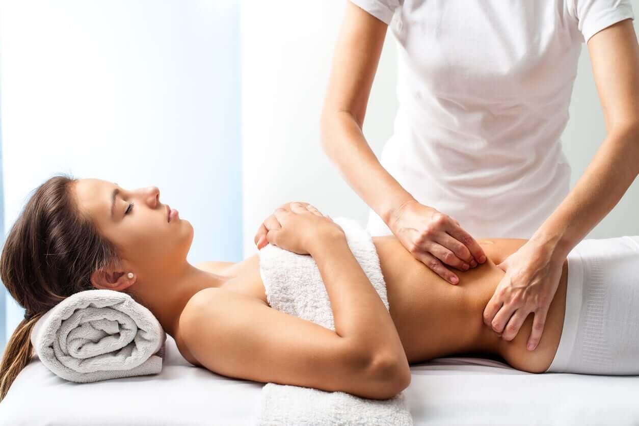 A woman receiving an abdominal massage.