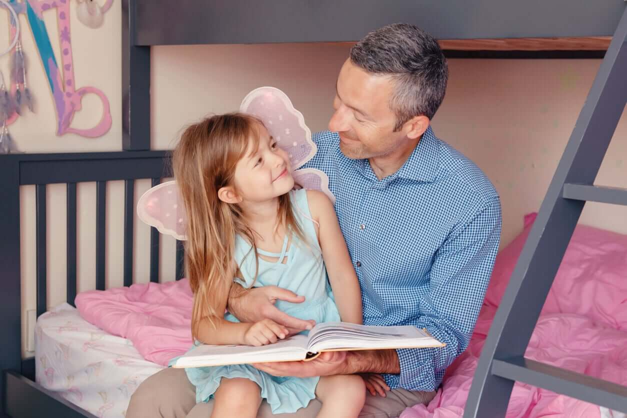 A father reading a story to his daughter.
