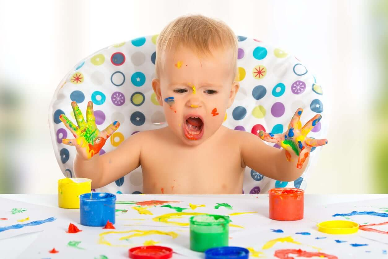 A baby finger painting.