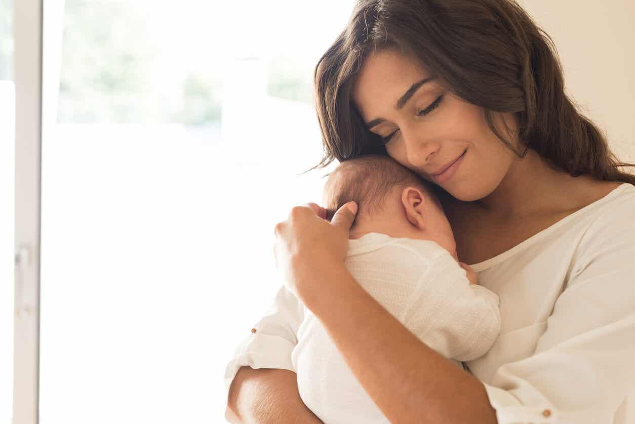 A mother embracing her newborn.