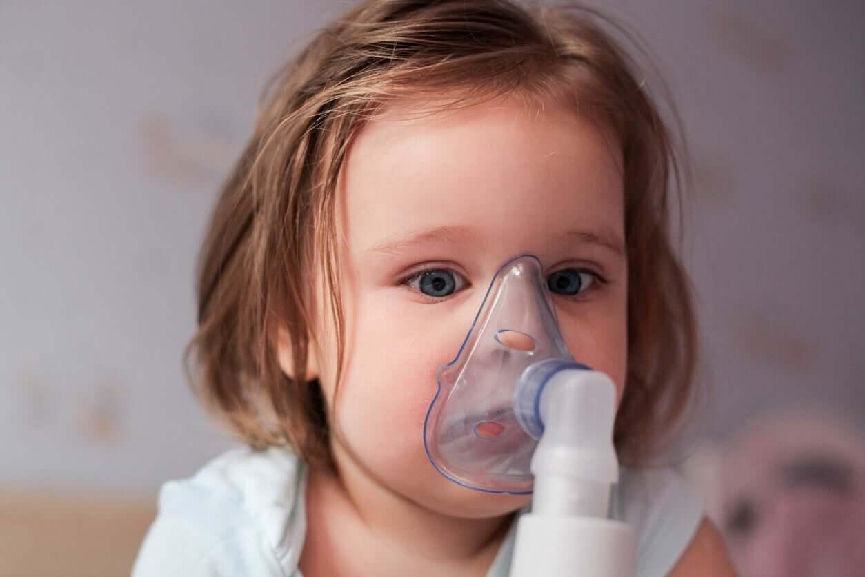 A baby using a nebulizer.