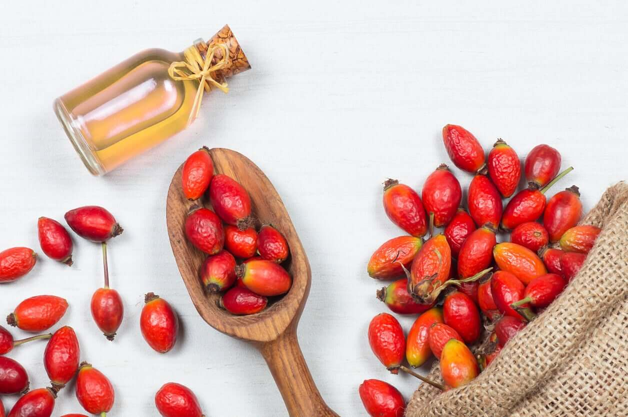 Rosehip and a bottle of rosehip oil.